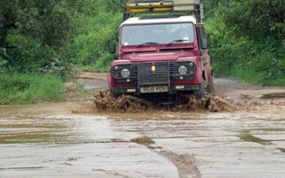 4WDing through river crossings while game driving in East Africa