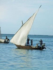 Enjoy a sundowner on the stunning beaches of Zanzibar while watching local fisherman set sail