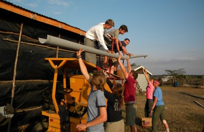 Hands on is what all our community service trips are about, here students installed gutters and water tanks to bring clean water to a poor farmer in Kenya