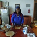 Dorin, at the Napenda Solar Community HQ, shows us how to make Chipati, traditional East African flat bread