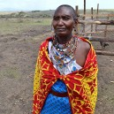 Mama Gitengi, the matriarch of the Gitengi family in rural Kenya comes to inspect Napenda Solar Project progress