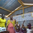 Another family celebrates as they turn on the solar power lights in their home in rural Kenya for the first time