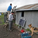 Solar Sally, Napenda Solar Community mascot, overlooks the group's progress while they install solar panels on this family home in Kajiado County, Kenya