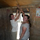 These students are running the house wires and fixing them in place ready for the solar power system in East Africa