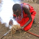 Getting some pointers on how to start a fire traditionally from the local Masai community.