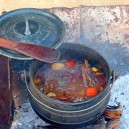 The most amazing stew you will ever taste, cooked for hours in our trusty potjie (Dutch oven).